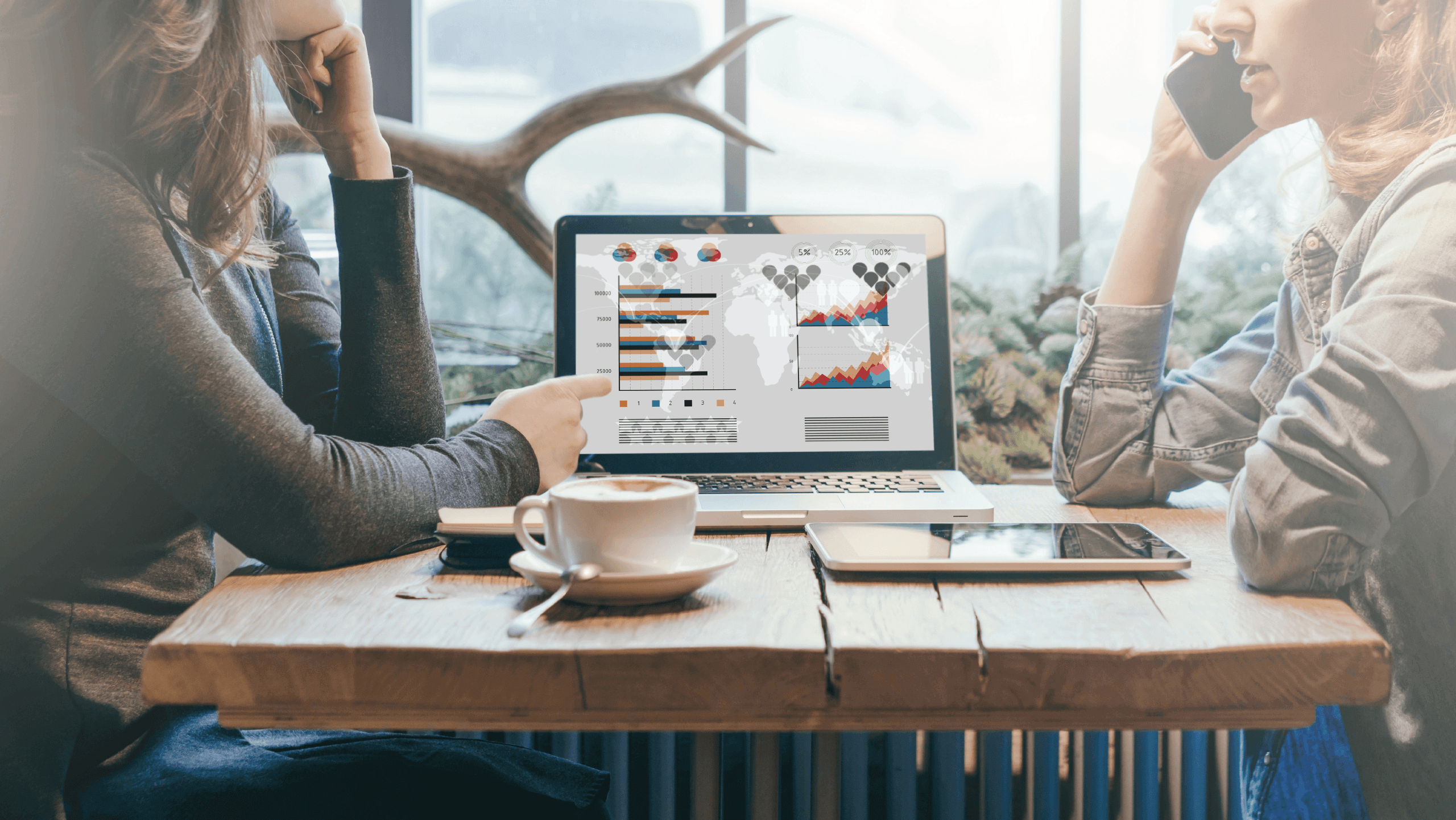 People looking at the screen with analytics of a small business marketing campaign