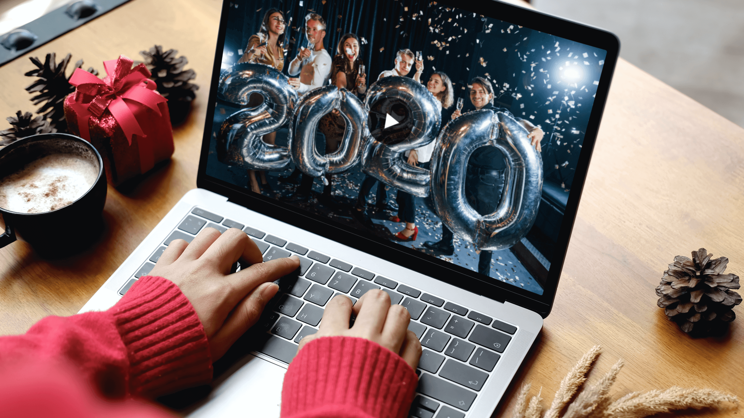 Woman watching New Year video on her laptop