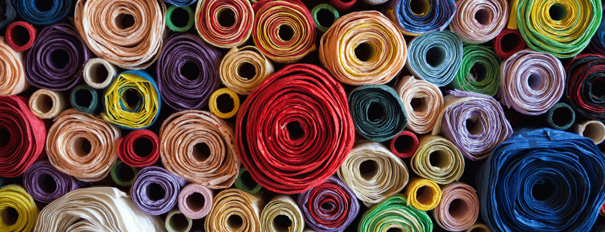 Rolls of different fabric types placed on each other
