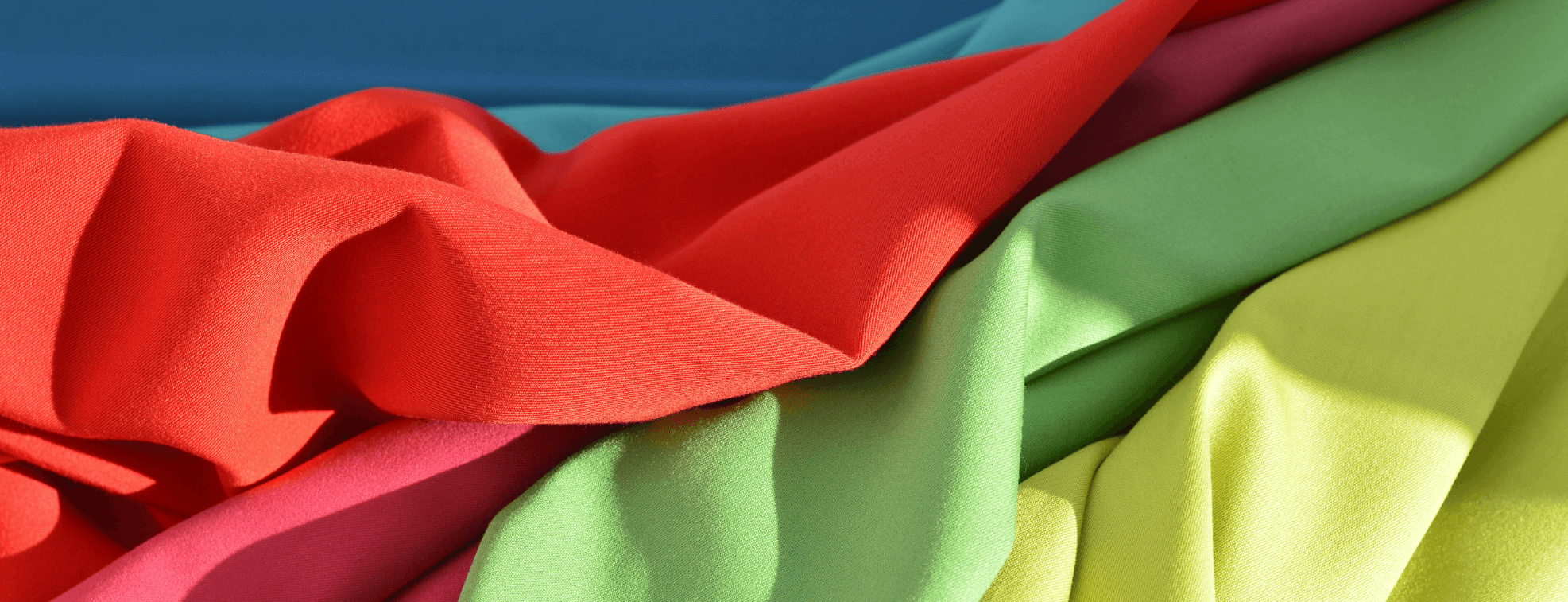Bright synthetic fabrics of different colored placed over each other