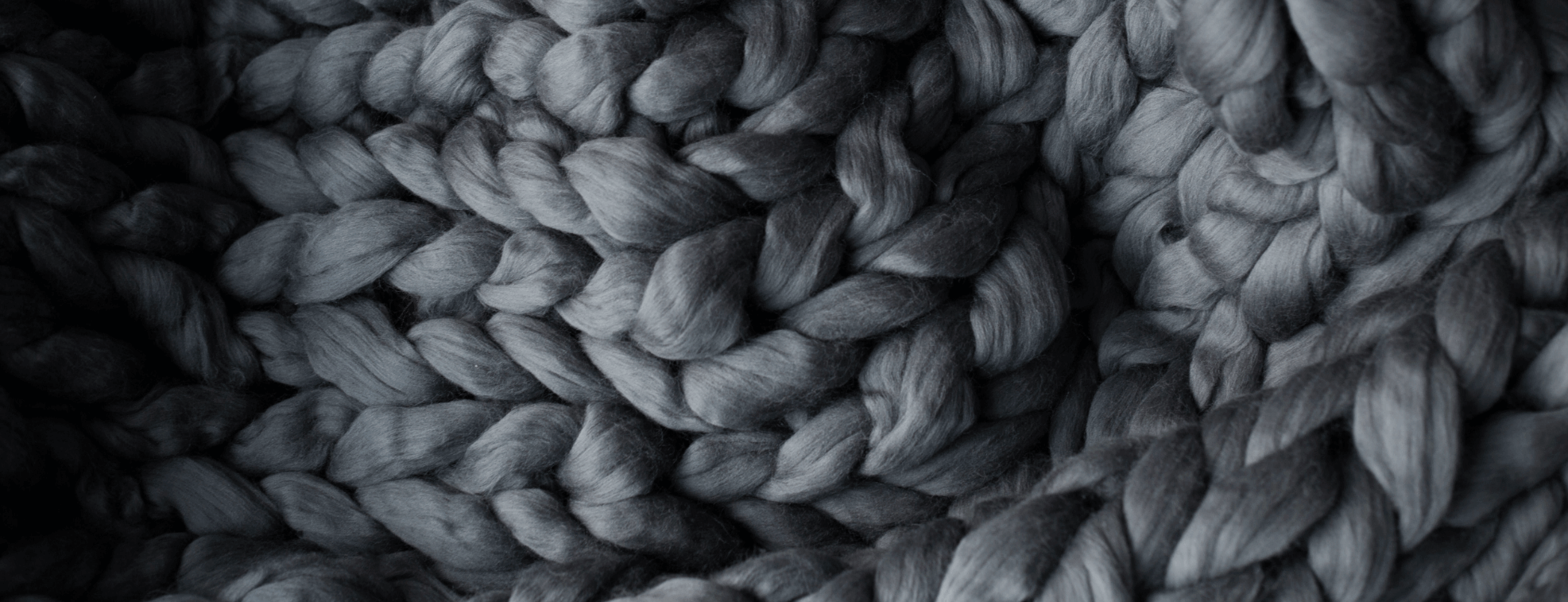 Knitted grey fabric with large knittings