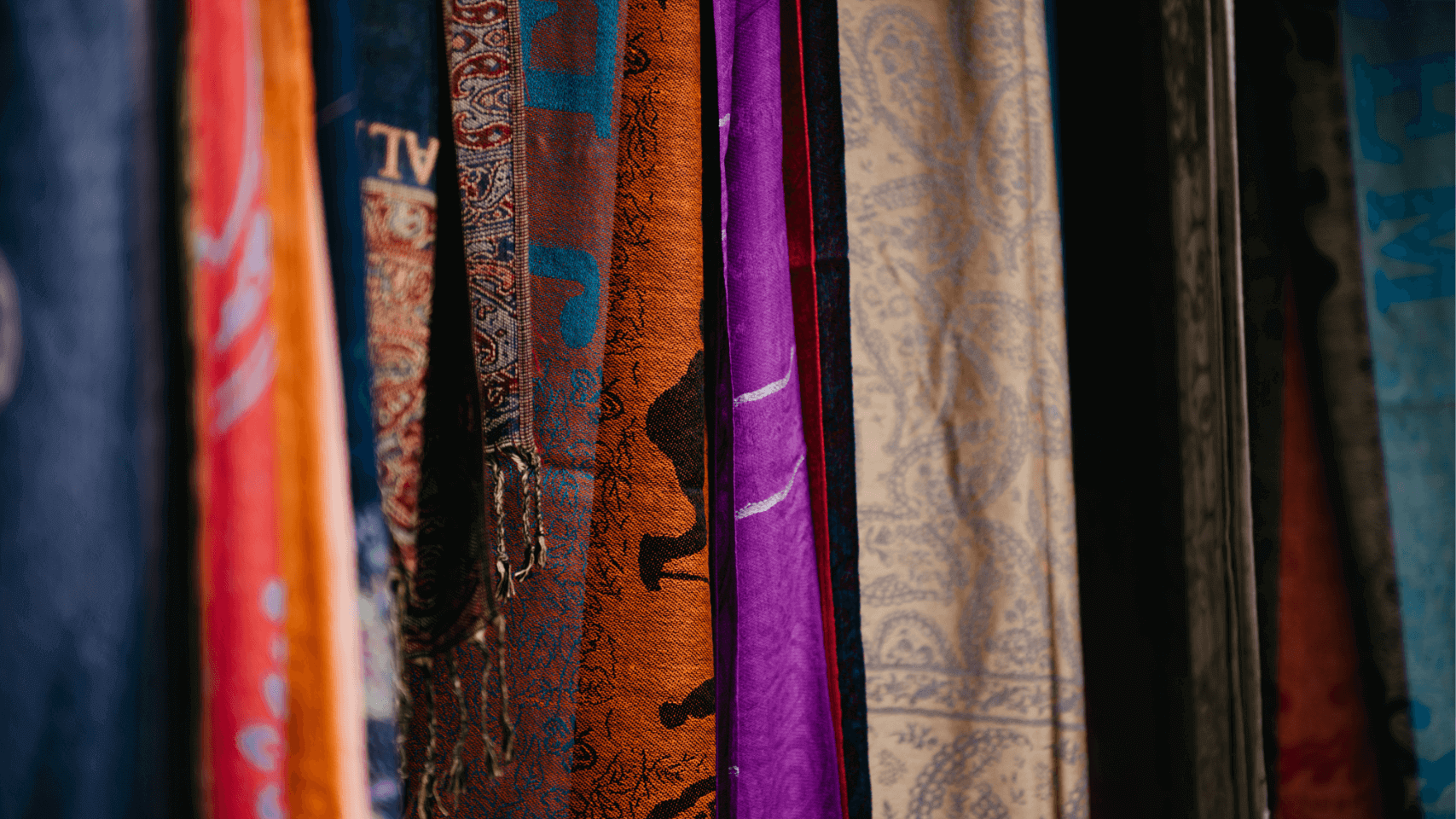 Cover image for an article about different types of fabrics with different fabrics hang next to each other
